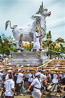 People carrying a raised, white bull character in a parade at a cremation ceremony for a high priest in Ubud, Bali, Indonesia Stock Photo - Premium Rights-Managednull, Code: 700-08385901