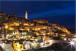 Overview of Sassi di Matera at night with the cathedral bell tower, one of the three oldest cities in the world, Basilicata, Italy