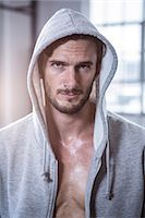 Fit shirtless man with hooded jumper Stock Photo - Premium Royalty-Freenull, Code: 6109-08398076