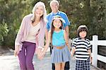 Older couple and grandchildren walking outdoors