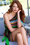 Beautiful auburn haired woman sitting in living room