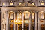 St Peter's Basilica, detail of the entrance and columns illuminated at dusk, Vatican City, Rome, Italy