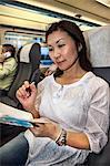 Mature woman passenge in train