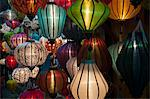 Vietnamese silk lanterns illuminated at night.