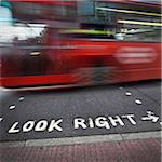 Look Right Sign at Crosswalk and Speeding Double Decker Bus, London, England, UK