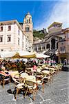 Tourists sitting on patio in the town square with the Amalfi Cathedral in the background, UNESCO World Heritage Site, Amalfi, Amalfi Coast, Italy