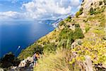 Hikers on the famous trail of Sentiero degli Dei (Path of the Gods) above the Amalfi Coast, Italy