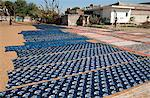 Newly Ajhrak (indigo) block printed lengths of fabric laid out in the sun to dry, Bagru, Jaipur, Rajasthan, India, Asia