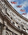 Top of the Admiralty Arch building with British Flags, London, England