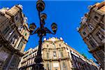 South, West and North buildings at Piazza Vigliena (Quattro Canti) with a silhouette of a lamp post on Corso Vittorio Emanuele in the historic center of Palermo in Sicily, Italy