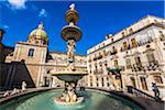 Buildings surrounding the Pretoria Fountain with central statues in Piazza Pretoria (Pretoria Square) in the historic center of Palermo in Sicily, Italy