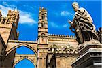 Statue of Archbishop and arcades connecting main building to the palace at the Palermo Cathedral in historic Palermo in Sicily, Italy