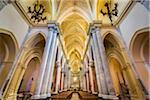 Architectural interior showing the main aisle lined with pilars in the elegant Royal Cathedral (Real Duomo) in historic Erice in Sicily, Italy
