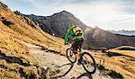 Cyclist on mountain biking area, Kleinwalsertal, trails below Walser Hammerspitze, Austria