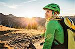 Cyclist enjoying view of mountain biking area, Kleinwalsertal, trails below Walser Hammerspitze, Austria