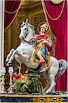 Statue of St George on a white horse in the Cathedral of Saint George (Duomo di San Giorgio) in Ragusa in Sicily, Italy