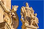 Ornate detail of mouldings and statue on the San Giuseppe Church against blue sky in Ragusa in Sicily, Italy