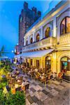 Wunderbar Caffe beside Torre dell'Orolorgio at Dusk in Piazza IX Aprile, Taormina, Sicily, Italy