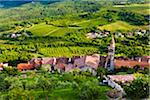 Overview of farmland and looking down on rooftops of the medieval town of Motovun in Istria, Croatia