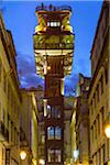 Front view of the historic Santa Justa Elevator illuminated at night in Santa Justa in the Baxia district of Lisbon, Portugal