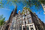 Top section of a tradtional building next to the De Krijtberg Church along Singel in Amsterdam, Holland