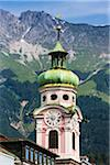 Baroque style 17th Century clock tower of Spitalkirche on Maria Theresien Strasse in Innsbruck, Austria