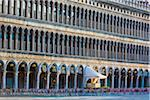 Cafe entrance and patio with empty seats on St Mark's Square at sunrise in Venice, Italy