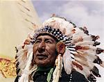 1960s NATIVE AMERICAN INDIAN MAN CHIEF GULL WEARING FEATHER BONNET MORLEY STONEY SIOUX FIRST NATIONS RESERVATION ALBERTA CANADA