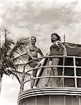 1930s 1940s MAN WOMAN COUPLE IN SWIM WEAR BATHING SUITS TROPICAL POOL SIDE VACATION HOTEL MIAMI BEACH FLORIDA USA