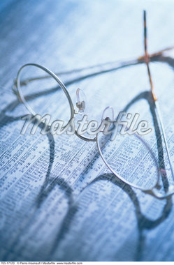 Eyeglasses and Financial Pages    Stock Photo - Premium Rights-Managed, Artist: Pierre Arsenault, Code: 700-00017123