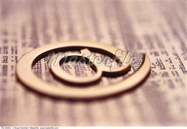 Close-Up of @ Symbol on Stock Page    Stock Photo - Premium Rights-Managed, Artist: Bryan Reinhart, Code: 700-00048359