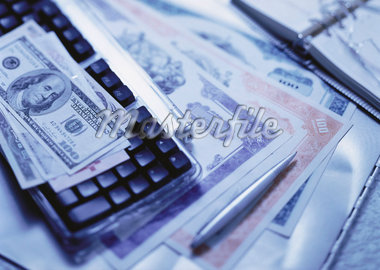 International Currency, Computer Keyboard and Stock Certificates    Stock Photo - Premium Rights-Managed, Artist: David Muir, Code: 700-00057336