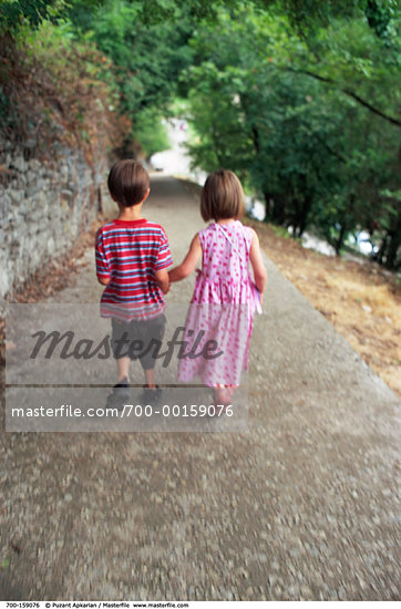 kids walk holding hands