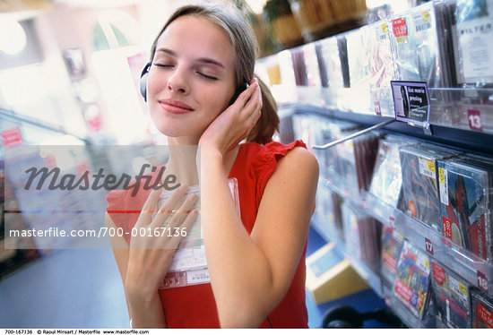 Teenager listening to a CD