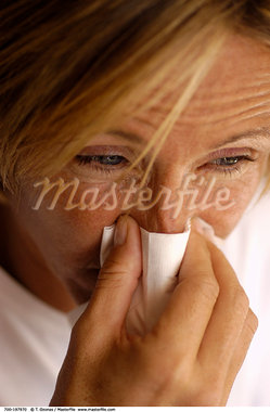 Woman Blowing Nose    Stock Photo - Premium Rights-Managed, Artist: T. Ozonas, Code: 700-00197970