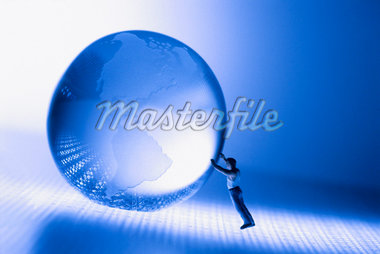 Man holding globe Stock Photo - Premium Royalty-Freenull, Code: 604-00223981