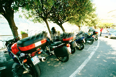 Motorbikes parked along the curb Stock Photo - Premium Royalty-Freenull, Code: 618-00486527