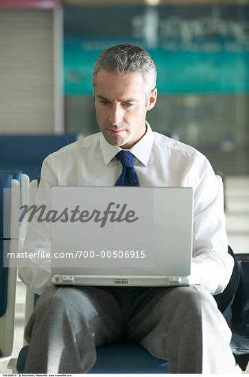 Businessman with Laptop    Stock Photo - Premium Rights-Managed, Artist: Pete Webb, Code: 700-00506915