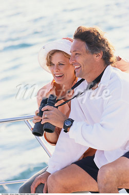 Woman and Man with Binoculars    Stock Photo - Premium Rights-Managed, Artist: Kevin Dodge, Code: 700-00529668