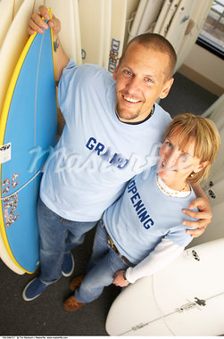 Couple With Surfboards, Starting New Business    Stock Photo - Premium Rights-Managed, Artist: Tim Mantoani, Code: 700-00546717