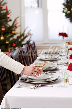 Woman Setting Table for Christmas Dinner    Stock Photo - Premium Rights-Managed, Artist: Jerzyworks, Code: 700-00547135