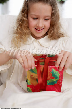 Girl Opening A Christmas Present    Stock Photo - Premium Rights-Managed, Artist: Jerzyworks, Code: 700-00547163