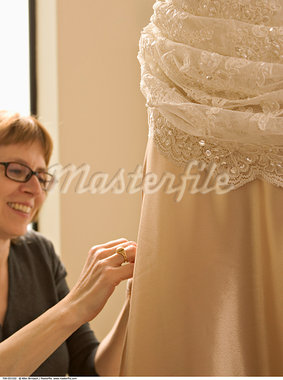 Seamstress Pinning Skirt    Stock Photo - Premium Rights-Managed, Artist: Allen Birnbach, Code: 700-00551532