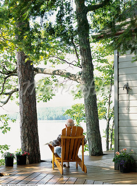 Man Sitting on Deck at Cottage    Stock Photo - Premium Rights-Managed, Artist: Jennifer Burrell, Code: 700-00551560