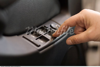 Woman Pressing Power Window Button in Car    Stock Photo - Premium Rights-Managed, Artist: Mike Randolph, Code: 700-00553745