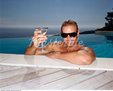 Man in Infinity Pool, Holding a Drink    Stock Photo - Premium Rights-Managed, Artist: Masterfile, Code: 700-00605045