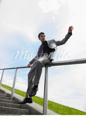 Man Sliding Down Railing    Stock Photo - Premium Rights-Managed, Artist: Masterfile, Code: 700-00611170