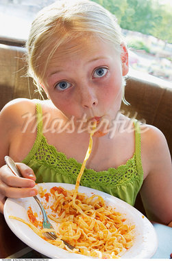 Girl Eating Noodles    Stock Photo - Premium Rights-Managed, Artist: Roy Ooms, Code: 700-00616885