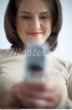 Woman Using Cellular Telephone    Stock Photo - Premium Rights-Managed, Artist: Jerzyworks, Code: 700-00641890