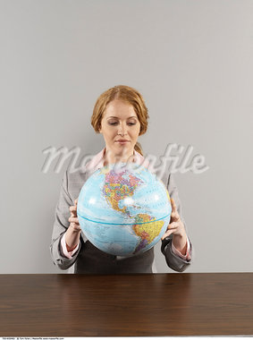 Portrait of Businesswoman Holding Globe    Stock Photo - Premium Rights-Managed, Artist: Tom Feiler, Code: 700-00659482